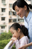 Mother and daughter on a balcony Royalty Free Stock Image