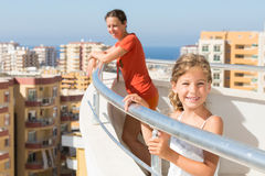 Mother and daughter on the balcony Stock Photos