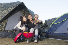 Mother and daughter barbecue on camping. In nature Stock Photo