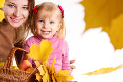 Mother and daughter with basket and leaves Stock Photo