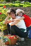 Mother and daughter with basket of vegetables Stock Images