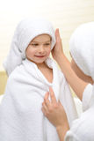 Mother and daughter in the bath room stock image