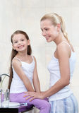 Mother and daughter are in bathroom Stock Photography