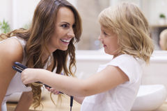 Mother and daughter in bathroom Royalty Free Stock Photos