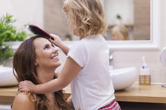 Mother and daughter in bathroom Royalty Free Stock Images