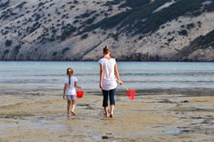 Mother and daughter be fishing nets in the sea Royalty Free Stock Photography