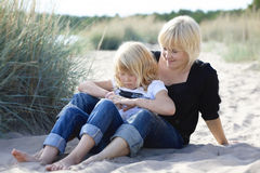 Mother and daughter at beach. Royalty Free Stock Image