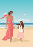 Mother and daughter on a beach. Mother and daughter on vacation, walking on a beach and smiling Royalty Free Stock Photo