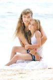 Mother and daughter on beach Stock Photography