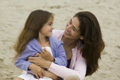 Mother and Daughter at the Beach Stock Images