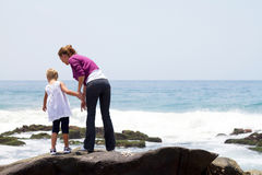 Mother daughter on beach Royalty Free Stock Image