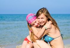 Mother and daughter on the beach Stock Photography