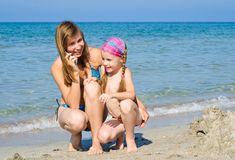 Mother and daughter on the beach Stock Photo