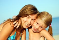 Mother and daughter on the beach Stock Image