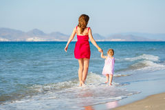 Mother and daughter on the beach Royalty Free Stock Photo