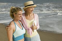 Mother and Daughter on Beach stock images