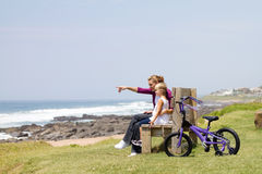 Mother daughter on beach bench Royalty Free Stock Images