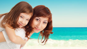 Mother with daughter on beach Royalty Free Stock Photos