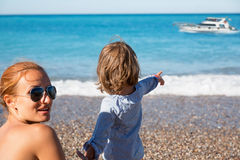 Mother and daughter on the beach. Happy mother and daughter having fun on the beach Stock Images