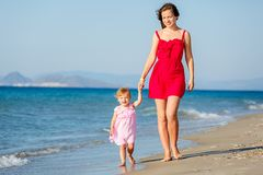 Mother and daughter on the beach Royalty Free Stock Image