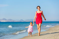 Mother and daughter on the beach Stock Images