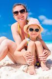 Mother and daughter at beach. Mother and daughter enjoying time at tropical beach royalty free stock images