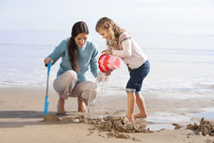 Mother and Daughter on Beach Stock Photos