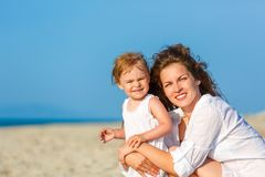 Mother and daughter on the beach stock photos