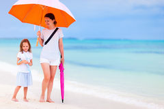 Mother and daughter at beach on rainy day Stock Photography