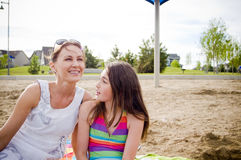 Mother and daughter at the beach talking Royalty Free Stock Photos