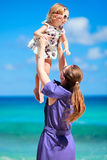 Mother and daughter on beach vacation Stock Photo