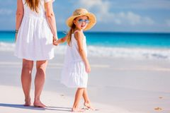 Mother and daughter at beach. Young mother and her adorable little daughter on summer beach vacation royalty free stock photography