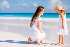 Mother and daughter at beach. Young mother and her adorable little daughter on summer beach vacation stock photography