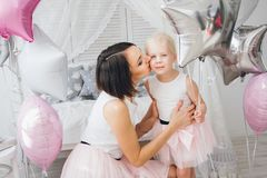 Mother and daughter in beautiful outfits celebrate the holiday stock images