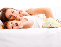 Mother and daughter in bed Royalty Free Stock Images