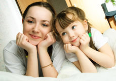 Mother and daughter on the bed Stock Images