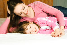 Mother and daughter in bed Stock Photos
