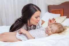 Mother and daughter in bed. Happy Mother and daughter in bed Stock Images