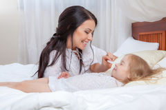Mother and daughter in bed Stock Image