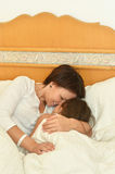 Mother with daughter in bed Stock Photo