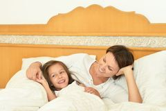 Mother with daughter in bed Stock Image