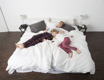Mother and Daughter in bed Stock Photography