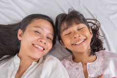 Mother and Daughter On Bed II Stock Images