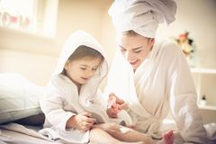 Soft skin. Mother and daughter. stock images