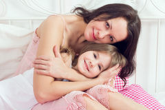 Mother and daughter on bed Royalty Free Stock Photos