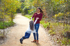 Mother and daughter being spun in circles Royalty Free Stock Photography