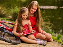 Mother and daughter on bicycle. Bikes cycling family. Royalty Free Stock Photos