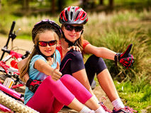 Mother and daughter on bicycle. Bikes cycling family. Royalty Free Stock Photo