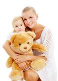 Mother and daughter with big toy Stock Photos