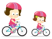 Mother and daughter biking 1 Royalty Free Stock Photography